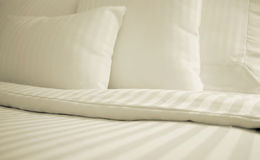 Simple White Bed stock photos