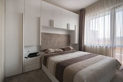 Simple white bedroom Stock Photos