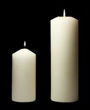 Simple white candles. White candles isolated on black Royalty Free Stock Photography