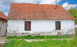 Simple white farmhouse with a red roof Stock Images