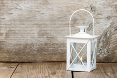 Simple white lantern on wooden background