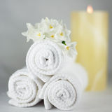 Simple white spa theme. Thick fluffy towels. Stock Photo