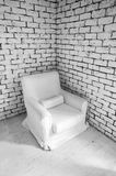 Simple white wall  interior. With armchair in corner Royalty Free Stock Photos