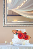 Simple White Wedding Cake With Flowers Stock Photo