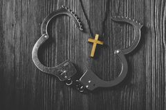 Simple Wood Cross and Unchain Handcuffs. Concept of Jesus Christ the Savior Liberate People from Sin royalty free stock photos
