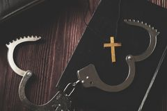Simple Wood Cross and Unchain Handcuffs. Concept of Jesus Christ the Savior Liberate People from Sin royalty free stock images