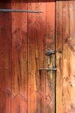 Simple wood door with old,rusty hardware Royalty Free Stock Photo