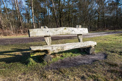 Simple wooden bench made of logs Stock Photography