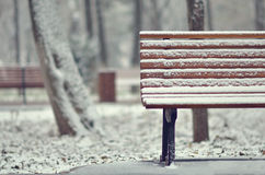 Simple wooden bench in snowy Stock Image