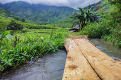 Simple  wooden bridge and farmer's house Royalty Free Stock Photography