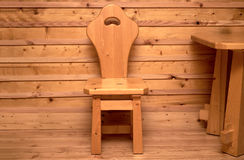 Simple wooden chair in wooden room Royalty Free Stock Image
