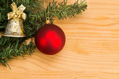 Simple wooden Christmas background with fir tree, ornament and b Royalty Free Stock Photos