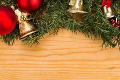 Simple wooden Christmas background with fir tree, ornaments and Royalty Free Stock Images