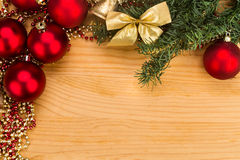 Simple wooden Christmas background with fir tree, ornaments and Royalty Free Stock Photos