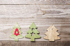 Simple wooden Christmas trees  on a green wooden background.Craf Stock Images