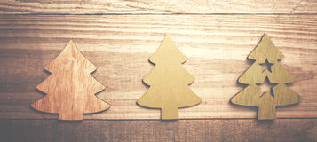 Simple wooden Christmas trees  on a green wooden background.Craf Stock Photos