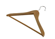 Simple wooden closet hanger with metallic hook Stock Photo