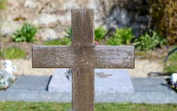 Simple wooden cross on a grave in a cemetery stock photography