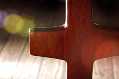 A Simple Wooden Cross on a Wooden Background Stock Photos