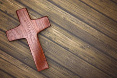 A Simple Wooden Cross on a Wooden Background Royalty Free Stock Photo
