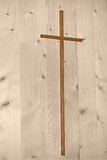 Simple wooden cross on wooden background. Simplicity. Rustic wood cross on paler wood panel stock images