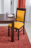 Simple wooden dinning table and chair in interior - studio ambie Royalty Free Stock Photography