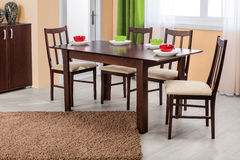 Simple wooden dinning table and chairs in interior - studio ambi Stock Images