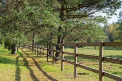 A simple wooden fence for horse pen. stock image