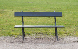 Simple wooden garden bench. In a park Stock Image