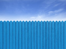 Simple wooden slat fence with parallel planks stained with royal Stock Photo