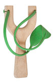 Simple wooden slingshot with green rubber band Royalty Free Stock Images