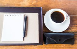 Simple work table with cup of coffee Stock Photos
