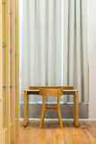 Simple working place in the room. Simple work place in the room with wooden furniture stock images