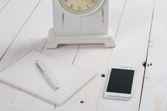 Simple workspace on wooden table Royalty Free Stock Image