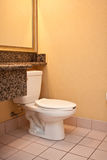 Simple yellow bathroom and toilet Stock Photography