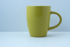 Simple yellow mug for drink Royalty Free Stock Images