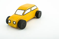 Simple yellow toy car Royalty Free Stock Image