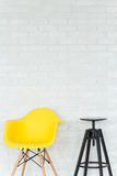 Simple, yellow, trendy chair Royalty Free Stock Photography