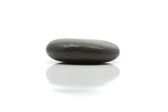Simplicity. Meditation concept with single pebble and reflection over white background Royalty Free Stock Photography