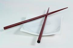 Simplicity. Chopsticks and plate Stock Photos