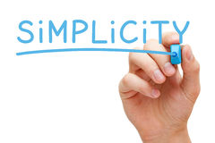 Simplicity Blue Marker. Hand writing Simplicity with blue marker on transparent wipe board isolated on white Stock Photo