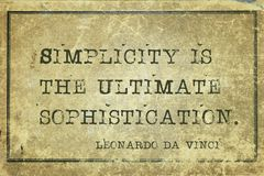Simplicity is DaVinci. Simplicity is the ultimate sophistication - ancient Italian artist Leonardo da Vinci quote printed on grunge vintage cardboard stock photos