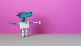 Free Simplified Robotic Computer Chat Bot With A Large Head Blue Screen And Space For Messages Or Text. Purple Gray Stock Photos - 186043463