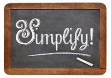 Simplifique la palabra en la pizarra Fotografía de archivo libre de regalías