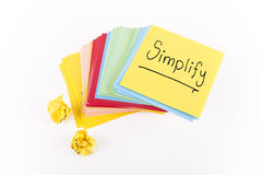 Simplify. Note on isolated white Stock Image
