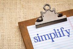 Simplify word on a clipboard Stock Photos