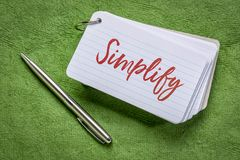 Simplify word on an index card stock photography