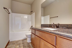 Simplistic bathroom with marble counters, and tile floor. Nice yet simplistic bathroom with tile floor Royalty Free Stock Photography