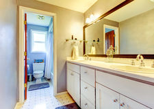 Simplistic bathroom with old style cabinets and tile trim. Northwest, USA Royalty Free Stock Photos