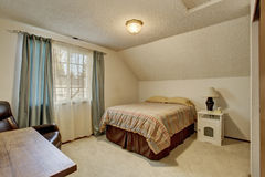 Simplistic bedroom with window and bed. Simplistic bedroom with carpet floor and bed Royalty Free Stock Images